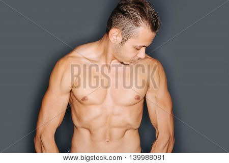 Torso of a tense man with perfect abdominal and chest muscles