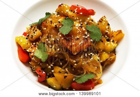 Salad with vegetables, rice noodles and sesame seeds
