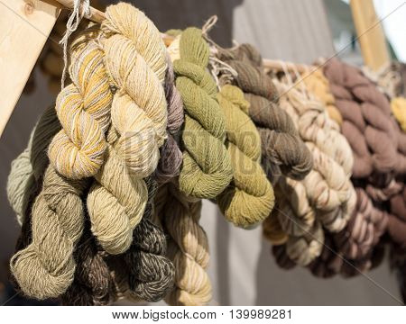Homemade different colour wool on the street market.