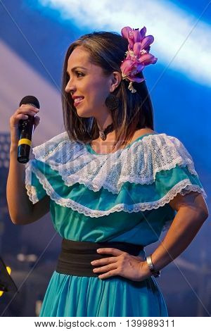 ROMANIA TIMISOARA - JULY 9 2016: Costa Rican singer in traditional costume perform one song during