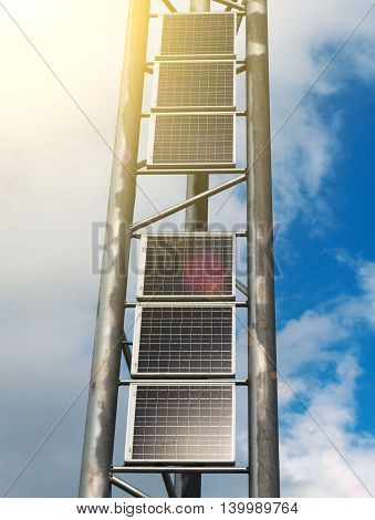 Vertical solar panels over blue sky background