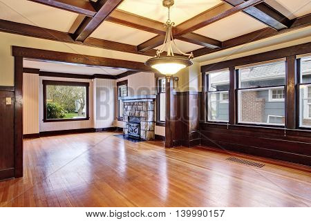 Empty Room With Wood Paneled Walls And Coffered Ceiling.