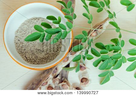 Moringa Leaf And Moringa Seed Grinded In The Bowl