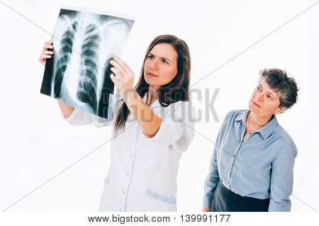 Patient standing behind doctor holding chest radiography - isolated on white