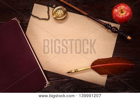 Vintage still-life with copy space. Role playing steampunk or fantasy concept. On wooden table background