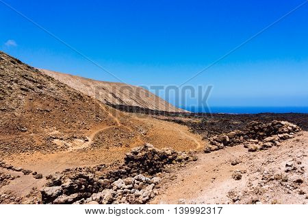 Desert formed by lava flows on the volcanic island of Lanzarote Spain