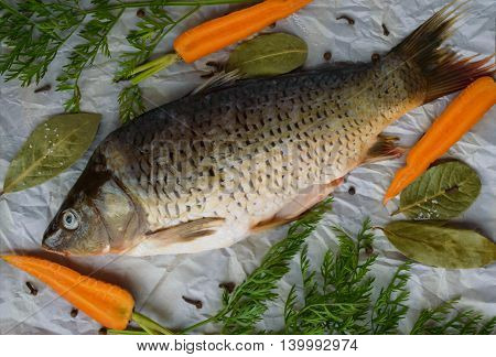River fish - bream with spices on a wooden background. The top view.