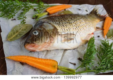 River fish - bream with spices on a wooden background.