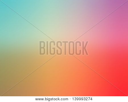 Abstract gradient rainbow red orange teal purple colored blurred background.