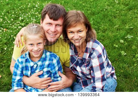 Portrait Of Happy Family In Garden. Father Mother Daughter