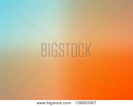 Abstract gradient orange teal blue colored blurred background.