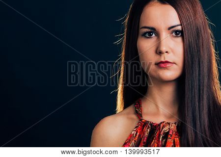 Portrait of a attractive beautiful woman posing - isolated on black.
