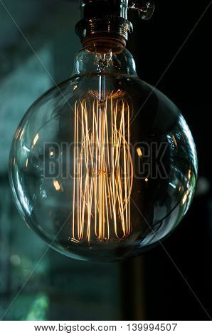 Pose of vintage old-fashioned incandescent bulb close-up