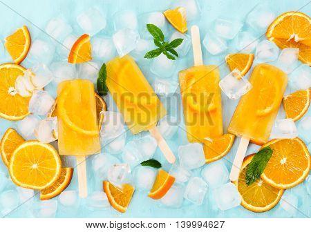 Fruit Homemade Popsicle Slices Of Orange On Light Blue Background.