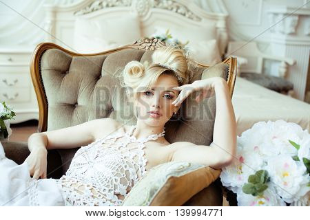 beauty emotional blond bride in luxury interior dreaming, crazy complicate hairstyle