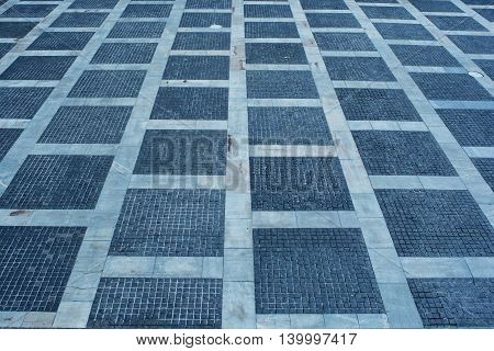 Abstract geometric background of Stone paving texture.