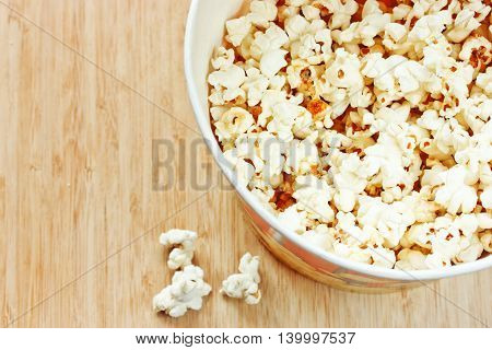 Popcorn snack on wooden background top view