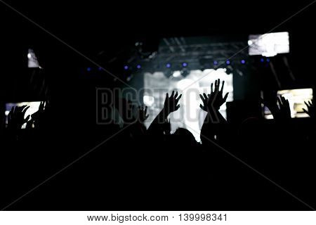 People at concert party on the music festival