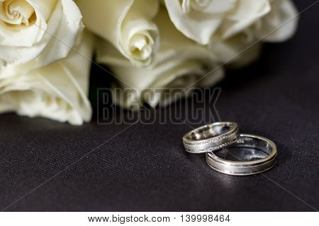 Wedding ring for bride and groom placed in an artistic ways
