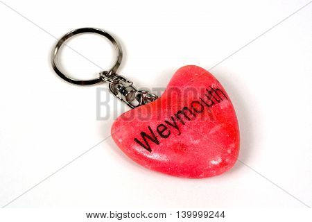 Pink stone heart key ring from Weymouth against a white background Weymouth Dorset England UK Western Europe.