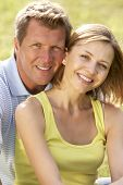 image of middle-age  - Middle aged couple having fun in countryside - JPG