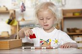 foto of montessori school  - Young Girl Playing at Montessori - JPG