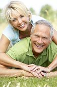 stock photo of portrait middle-aged man  - Mature couple having fun in countryside - JPG