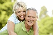 foto of woman couple  - Mature couple having fun in countryside - JPG