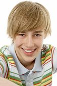 pic of close-up shot  - Studio Portrait Of Smiling Teenage Boy - JPG