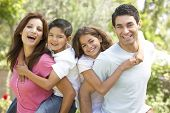 stock photo of happy family  - Portrait of Happy Family In Park - JPG