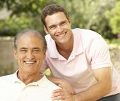 stock photo of mature adult  - Senior Man Hugging Adult Son - JPG