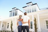 foto of dream home  - Young Couple Standing Outside Dream Home - JPG