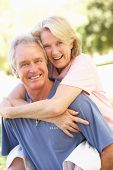 stock photo of old couple  - Portrait Of Romantic Senior Couple In Park - JPG