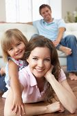 stock photo of happy family  - Portrait Of Happy Family Relaxing At Home - JPG
