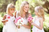 pic of flower girl  - Bride With Bridesmaids Outdoors At Wedding - JPG