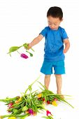 foto of physically handicapped  - Asian boy with light handicap and a colorful bouquet tulips - JPG