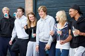 image of underage  - Group Of Teenagers Hanging Out Together Outside Drinking - JPG