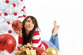picture of xmas tree  - young woman with gift box next to white christmas tree - JPG