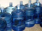 stock photo of bottle water  - a double row of bottled sterilized water - JPG