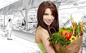picture of healthy food  - woman holding a  bag full of healthy food - JPG