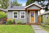 Small American House With Gray Exterior Paint. poster