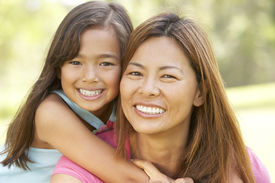 stock photo of mother child  - Mother And Daughter Enjoying Day In Park - JPG