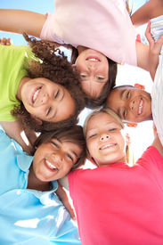 stock photo of children group  - Group Of Children Looking Down Into Camera - JPG
