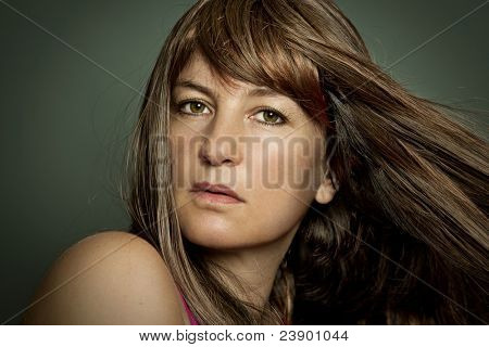 beautiful portrait of a girl with long brown hair
