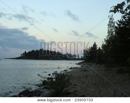 The moon over Ladoga lake in a gulf