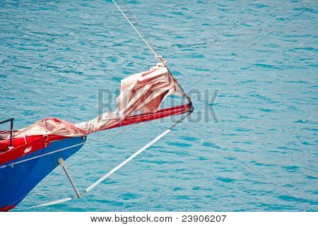 Bow Of Red And Blue Sailing Ship