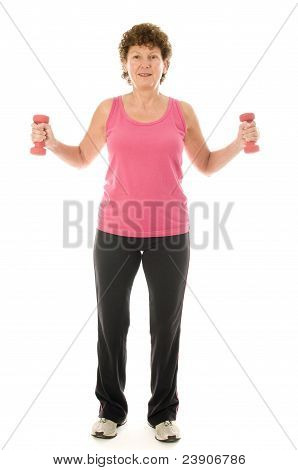 Senior Middle Age Woman Exercising With Dumbbells