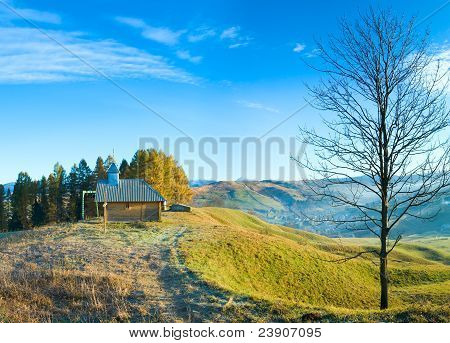 Wooden Chapel On Autumn Mountain Top