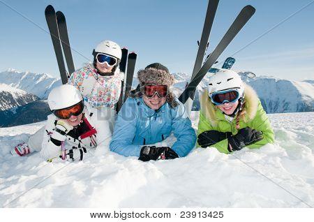 Happy ski vacation - skiers portrait