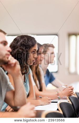 Portrait of students listening a lecturer in an amphitheater